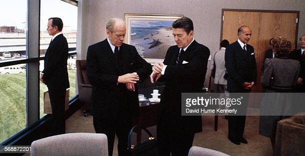 United States President Ronald Reagan and former President Gerald Ford check their watches at the Dedication of the Gerald R Ford Presidential Museum...