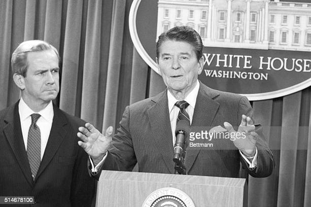 United States President Ronald Reagan announces the resignation of national security adviser Robert McFarlane standing beside him to be replaced with...