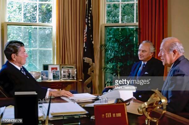 United States President Ronald Reagan seated behind his Oval Office desk meets with USAmbassador to the Soviet Union Arthur Hartman and with...