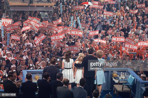 United States Presidential candidate Richard Nixon standing with his family in front of political supporters at the 1968 Republican Convention in...