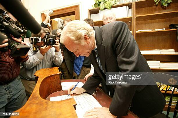 United States Presidential Candidate Senator Joe Lieberman signs the necessary campaign documents to participate in the New Hampshire Primary at the...