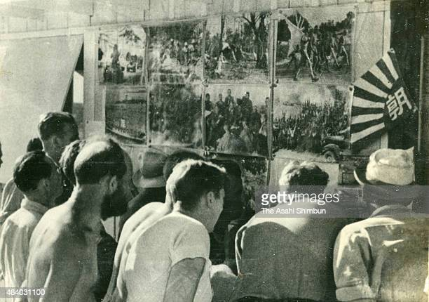 United States prisoners of war watch the photo news report of the Pacific War by the Asahi Shimbun on April 2 1942 in Wake Island United States Wake...
