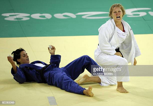 United States' Ronda Rousey reacts as she won against Hungary's Anett Meszaros during their women's 70kg judo match of the 2008 Beijing Olympic Games...