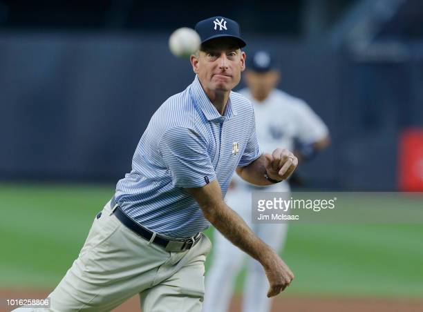 United States Ryder Cup Captain Jim Furyk throws the ceremonial first pitch of a game between the New York Yankees and the New York Mets at Yankee...