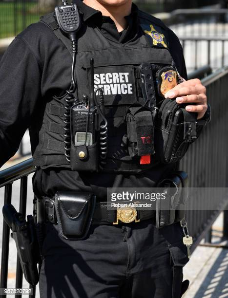 United States Secret Service officer stands guard along Pennsylvania Avenue in front of the White House in Washington DC