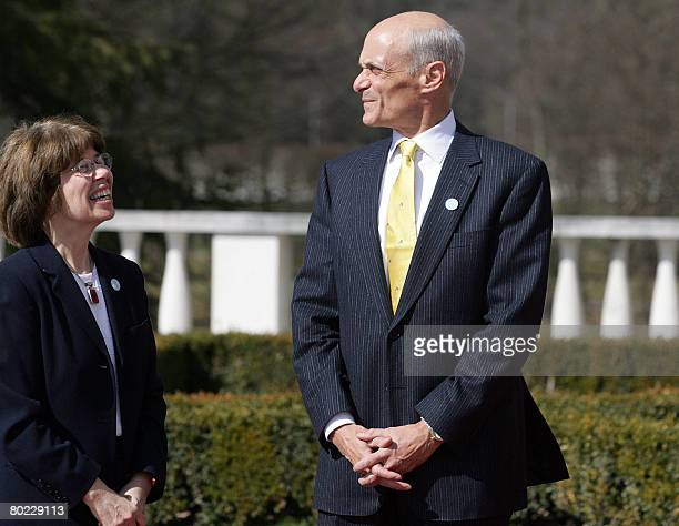 United States Secretary of Homeland Security Michael Chertoff heads of the the US delegation and Mary Ruth Coleman, a US delegation member, pose...
