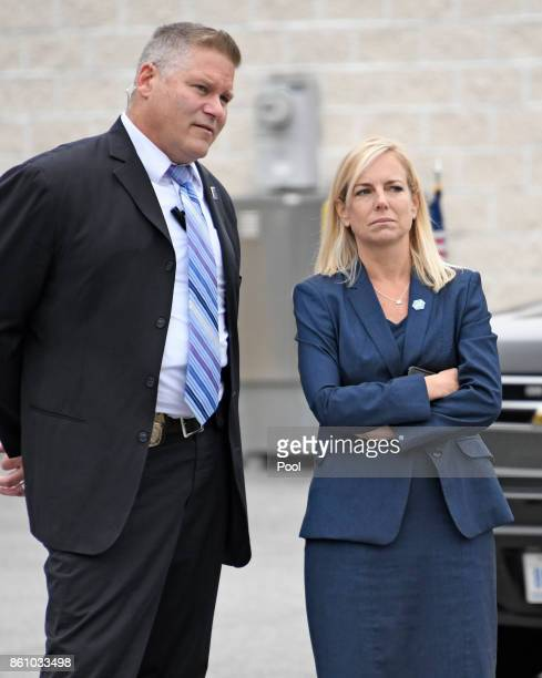 United States Secretary of Homeland Securitydesignate Kirstjen Nielsen right and an unidentified Secret Service agent look on as US President Donald...