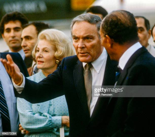 United States Secretary of State Alexander Haig gestures as he speaks the Egyptian President Anwar Sadat at the latter's departure ceremony at...
