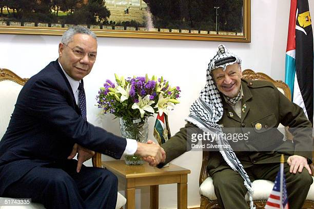 United States Secretary of State Colin Powell shakes hands with Palestinian President Yasser Arafat June 28 2001 at the start fo their meeting at...