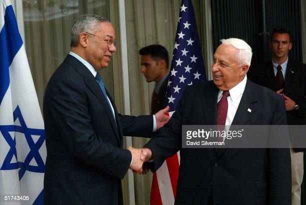 United States Secretary of State Colin Powell shakes hands with Israeli Prime Minister Ariel Sharon May 11 2003 at the start fo their meeting at...