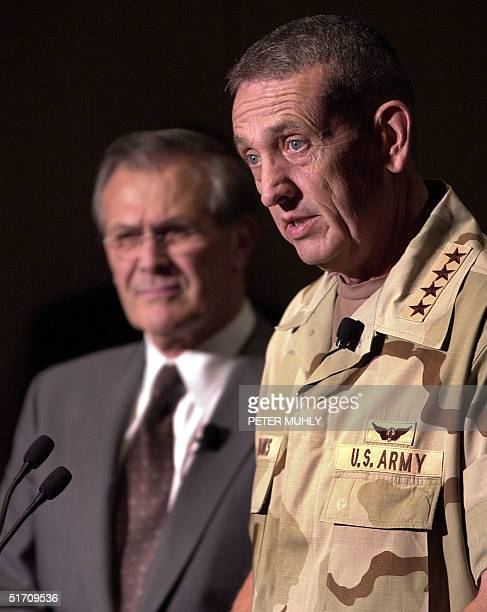 United States Secretary of State Donald H Rumsfeld as US Army General Tommy R Franks talks with the media 27 November 2001 before giving the...