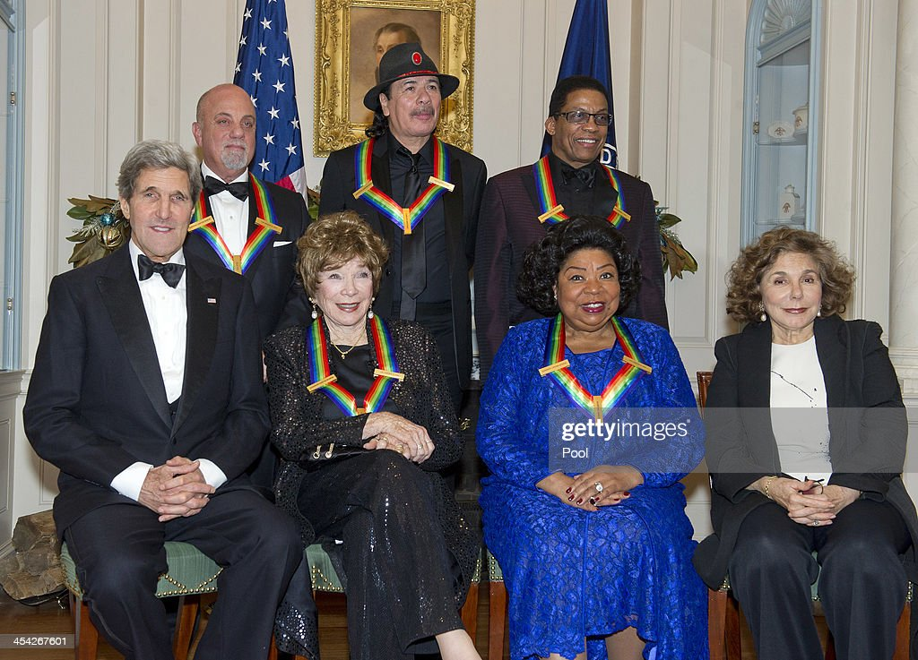United States Secretary of State John F. Kerry , Billy Joel, Shirley MacLaine, Carlos Santana, Martina Arroyo, Herbie Hancock and Teresa Heinz Kerry attend the formal Artist's Dinner honoring the recipients of the 2013 Kennedy Center Honors hosted by United States Secretary of State John F. Kerry at the U.S. Department of State on December 7, 2013 in Washington, D.C. The 2013 honorees are: opera singer Martina Arroyo, musician/composer Herbie Hancock, singer/songwriter Billy Joel, actress Shirley MacLaine, and musician/songwriter Carlos Santana.