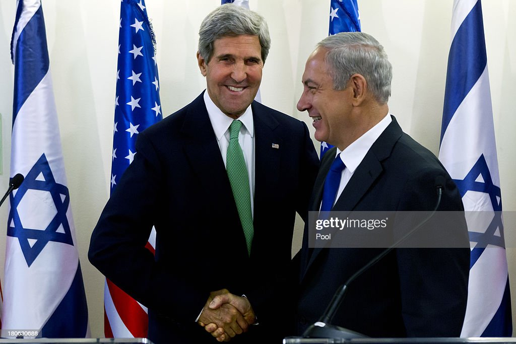 United States Secretary of State John Kerry (L) and Israeli Prime Minister Benjamin Netanyahu shake hands at the conclusion of their statements after their lengthly meeting in the prime minister's Jerusalem offices, September 15, 2013 in Jerusalem, Israel. The two discussed the need to remove all of Syria's chemical weapons, and the need to progress with the Middle East peace process with the Palestinians, something Kerry said he would do without talking about it until the end of the process. Most of the statements by both leaders dealt with Syria and their use of chemical weapons.