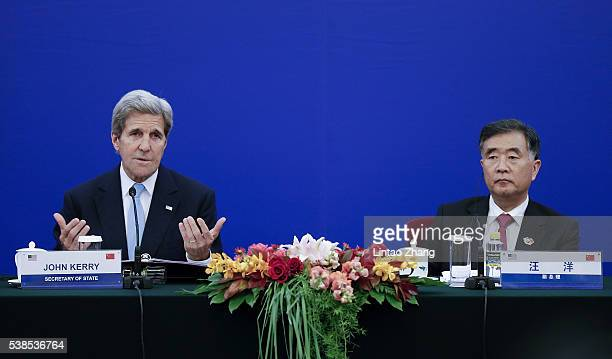 United States Secretary of State John Kerry launches a speech with Chinese Vice Premier Wang Yang during the closing ceremony of the eighth round of...