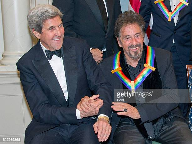United States Secretary of State John Kerry left shakes hands with actor Al Pacino right as they prepare prepare to pose with the five recipients of...