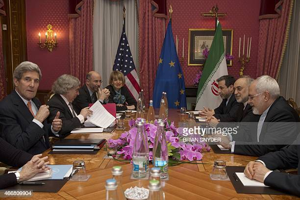 United States Secretary of State John Kerry sits with his delegation during a negotiation meeting concerning Iran's nuclear program with Iran's...