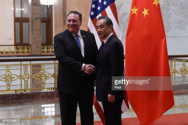 United States Secretary of State Mike Pompeo is greeted by Chinese Foreign Minister Wang Yi prior to their meeting in the Great Hall of the People on...