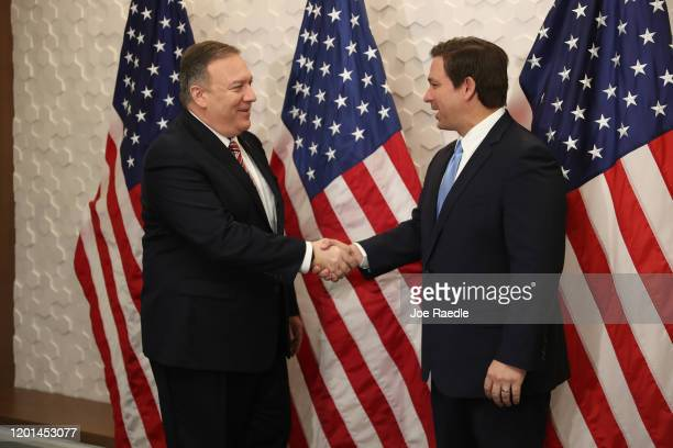United States Secretary of State Mike Pompeo shakes hands with Florida Governor Ron DeSantis before taking part in a roundtable discussion at the...