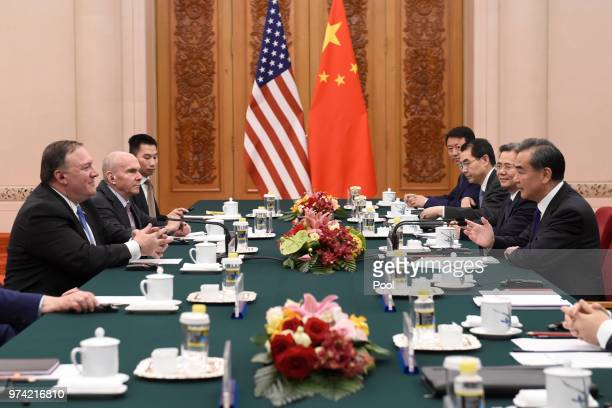 United States Secretary of State Mike Pompeo speaks with Chinese Foreign Minister Wang Yi during their meeting in the Great Hall of the People on...
