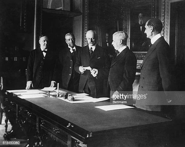 United States Secretary of State Robert Lansing hands Danish Minister Brun a draft for $25000 in purchase of the Danish West Indies Pictured are...