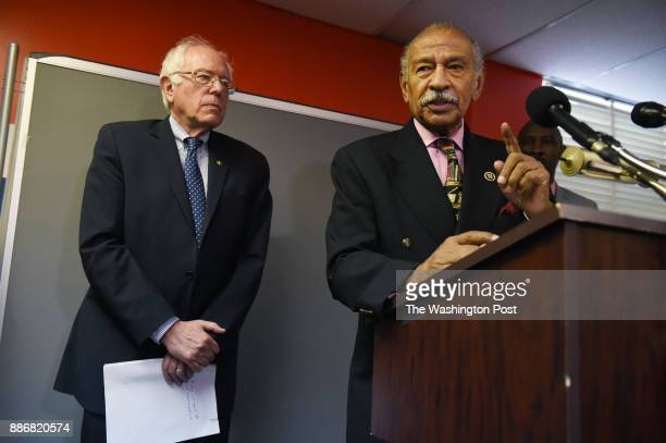 United States Senator Bernie Sanders left stands next to United States Representative John Conyers Jr right as they announce a bill called Employ...