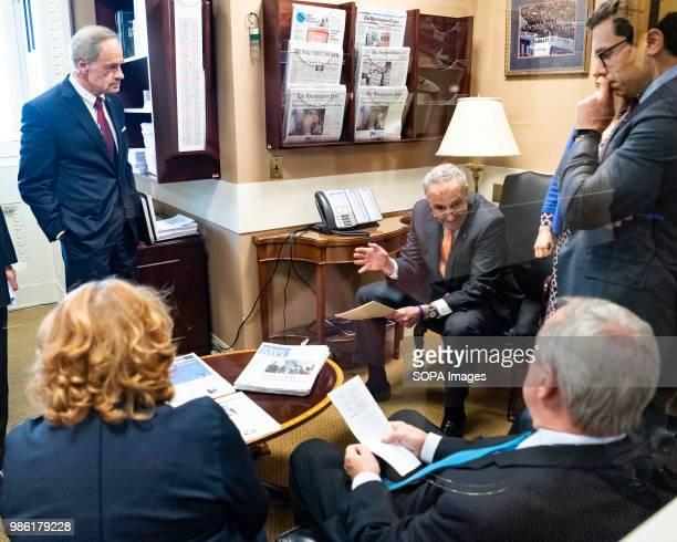 United States Senator Chuck Schumer in discussion with Senators Dick Durbin Tom Carper and Heidi Heitkamp before a press conference about the...