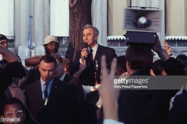 United States Senator from Minnesota and Democratic Party candidate for the Presidential nomination Eugene McCarthy uses a microphone to speak to...