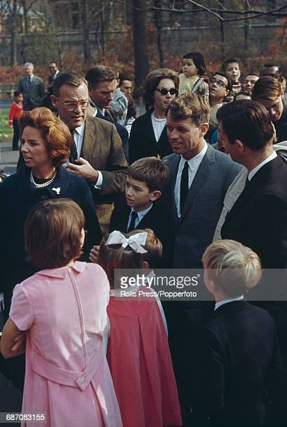 United States Senator from New York Robert F Kennedy pictured with his wife Ethel Kennedy five of their children and various aides on a street in the...