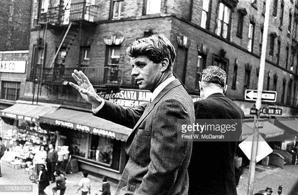 United States Senator Robert F Kennedy waves to supporters on East 111th Street in HArlemas he campaigns on behalf of a local NYC candidate New York...