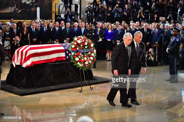 United States Senators Chuck Schumer and Mitch McConnell walk after viewing the casket of former Senator John McCain in the Capitol Rotunda where he...
