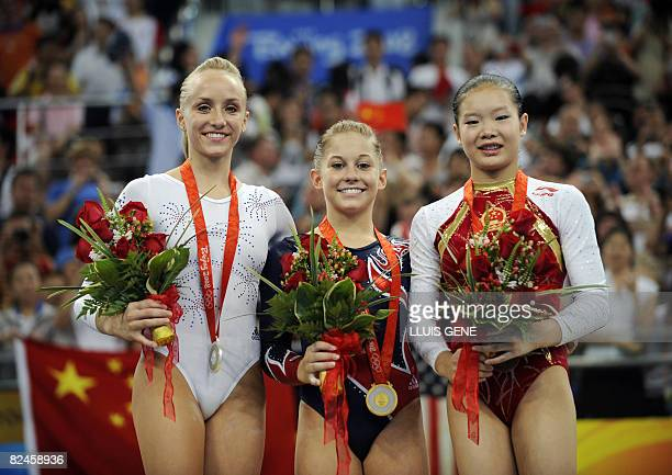 United States' Shawn Johnson United States' Nastia Liukin and China's Fei Cheng stand on the podium after the women's balance beam final of the...