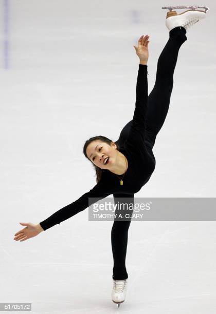 United States skater Michele Kwan practices her routine during training at the Salt Lake Ice Center 08 February 2002 in preparation for the 2002 Salt...