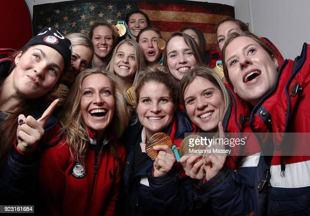 United States Snowboard gold medalist Jamie Anderson poses for a selfie with some members of the United States Women's Hockey Team and their gold...