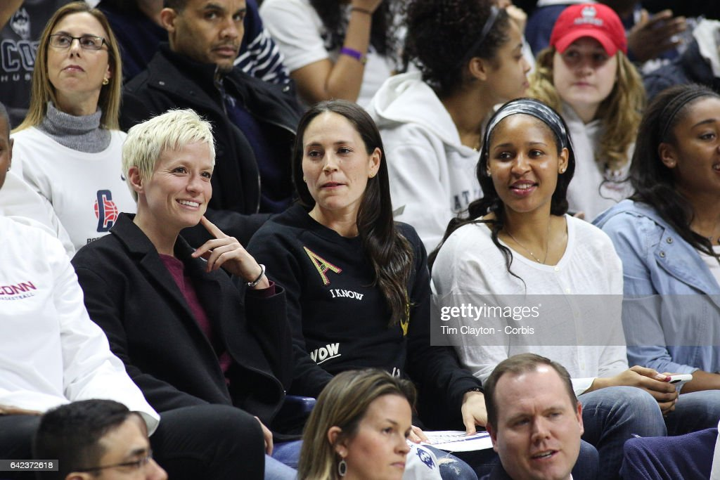 United States soccer player Megan Rapinoe with former UConn basketball players Sue Bird and Maya Moore, watching the UConn side as they go for their one hundreth consecutive win during the UConn Huskies Vs South Carolina Gamecocks NCAA Women's Basketball game at Gampel Pavilion, on February 13th, 2017 in Storrs, Connecticut.