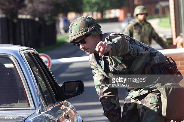 United States soldier checks cars September 13 2001 at RAF Mildenhall Suffolk United Kingdom after security was tightened at the air force base used...