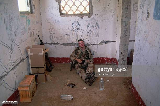 United States soldiers grabs some shuteye after having taken position in a shelledout building with his troops In the 1980s civil war erupted in...
