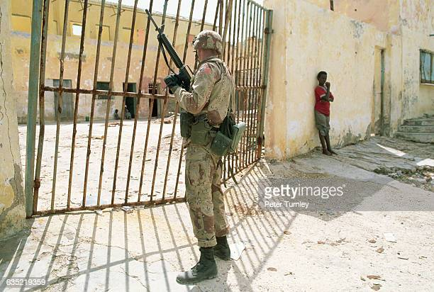 A United States soldiers pauses in front of a gate during his patrol of Mogadishu US and international troops entered the country in December of 1992...