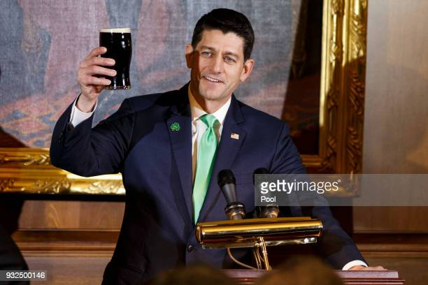 United States Speaker of the House of Representatives Paul Ryan Republican of Wisconsin holds up a pint of Guinness as he proposes a toast during the...