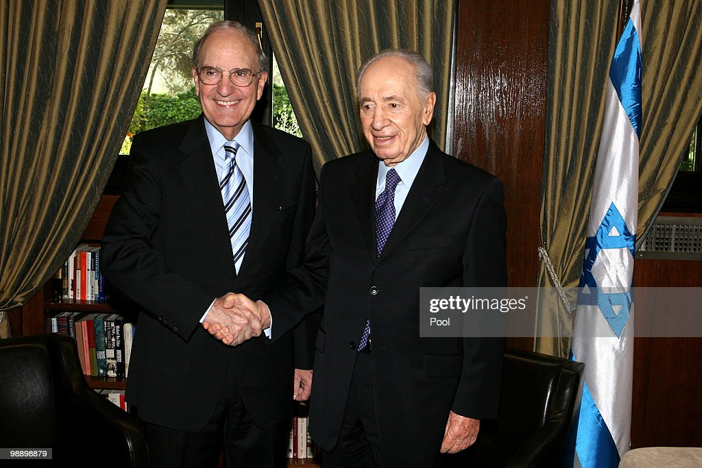United States Special Middle East envoy George Mitchell (L) shake hands with Israeli President Shimon Peres on May 07, 2010 in Jerusalem, Israel. The US envoy is on a three day visit in the Middle East to hold peace talks with Israeli leaders.