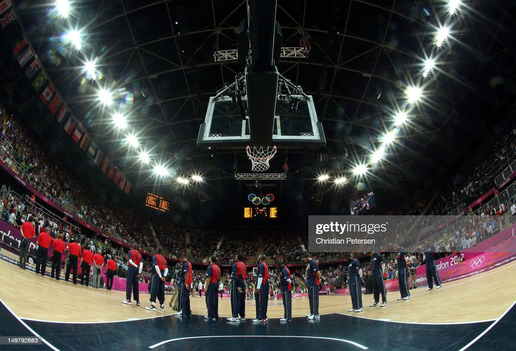 United States stands attended for the National Anthem before the Men's Basketball Preliminary Round match against Lithuania on Day 8 of the London 2012 Olympic Games at the Basketball Arena on August 4, 2012 in London, England.
