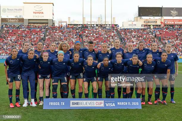 United States starting XI and all other players pose for a team photo with their jersey's worn inside out during the SheBelieves Cup match between...