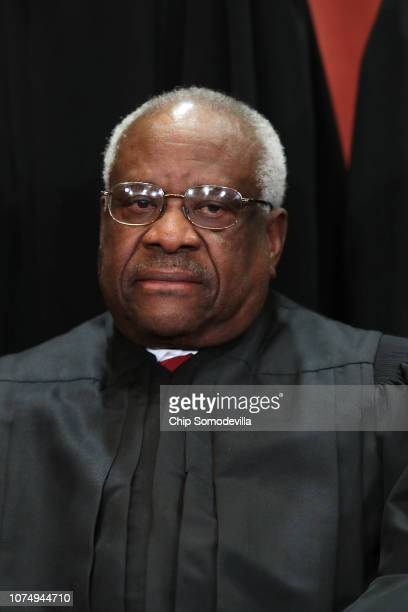 United States Supreme Court Associate Justice Clarence Thomas poses for the court's official portrait in the East Conference Room at the Supreme...