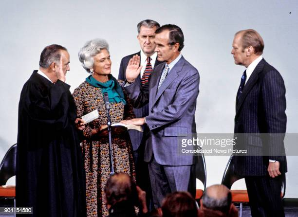 United States Supreme Court Associate Justice Potter Stewart swears in former Senator George HW Bush as Director of the Central Intelligence Agency...