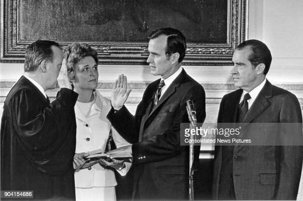 United States Supreme Court Associate Justice Potter Stewart swears in former Senator George HW Bush as US Ambassador to the United Nations...