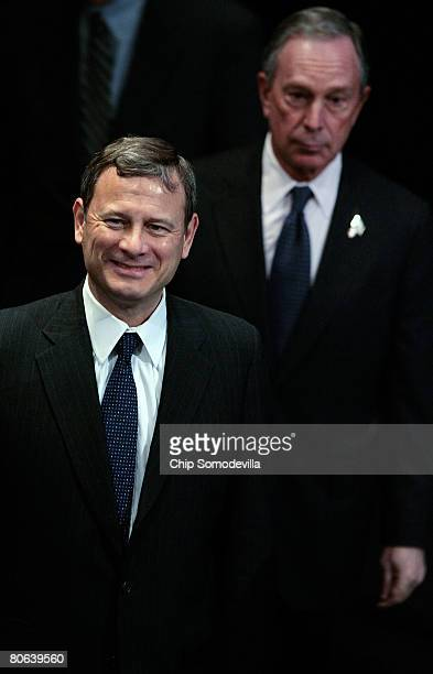 United States Supreme Court Chief Justice John Roberts and New York City Mayor Michael Bloomberg arrive for the dedication ceremony of the Newseum...