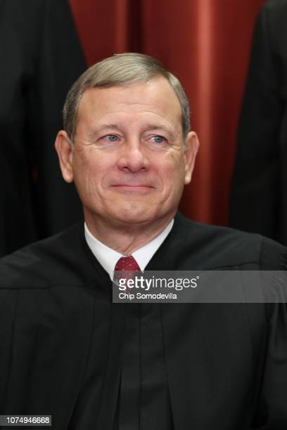 United States Supreme Court Chief Justice John Roberts poses for the court's official portrait in the East Conference Room at the Supreme Court...