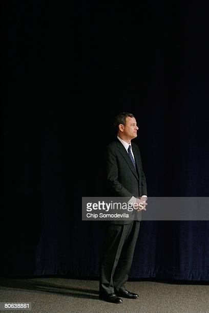 United States Supreme Court Chief Justice John Roberts prepares to take the stage to address the dedication ceremony during the grand opening of the...
