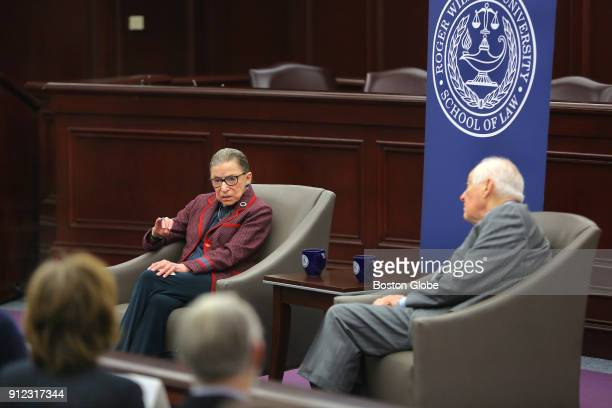 United States Supreme Court Justice Ruth Bader Ginsburg left answers audience questions during an event at Roger Williams University Law School in...