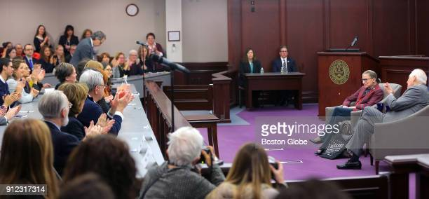 United States Supreme Court Justice Ruth Bader Ginsburg second from right speaks during an event at Roger Williams University Law School in Bristol...