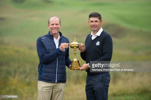 United States Team Captain, Steve Stricker and Europe Team Captain, Padraig Harrington pose for a photo with the ryder cup trophy during the Ryder...